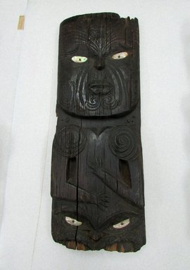 Maori. <em>Panel  (Poupou)</em>. Wood, pāua shell, 34 1/2 x 12 3/4 x 2 3/8 in.  (87.6 x 32.4 x 6.0 cm). Brooklyn Museum, Brooklyn Museum Collection, X839.5. Creative Commons-BY (Photo: , CUR.X839.5.jpg)
