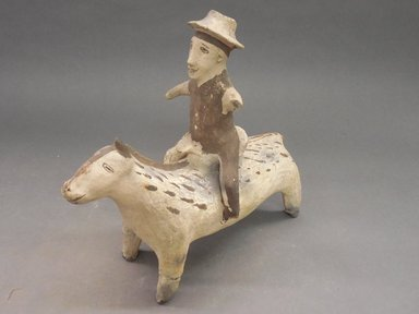 She-we-na (Zuni Pueblo). <em>Effigy Vessel in the Shape of a Man with a Hat on a Horse</em>, 19th century, ca. 1875. Clay, slip, pigment, 9 1/2  x 10 1/4 x 4 1/4 in. (24.1 x 26 x 10.5 cm). Brooklyn Museum, Brooklyn Museum Collection, X898.11. Creative Commons-BY (Photo: Brooklyn Museum, CUR.X898.11_view1.jpg)