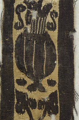 Coptic. <em>Band Fragment with Potted Botanical Decoration</em>, 4th-7th century C.E. Flax, wool, 4 3/4 x 2 in. (12.1 x 5.1 cm). Brooklyn Museum, Brooklyn Museum Collection, X934. Creative Commons-BY (Photo: Brooklyn Museum (in collaboration with Index of Christian Art, Princeton University), CUR.X934_detail01_ICA.jpg)