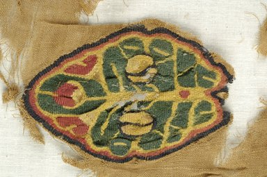 Coptic. <em>Fragment with Botanical Decoration</em>, 5th-6th century C.E. Flax, wool, 9 3/4 x 9 in. (24.8 x 22.9 cm). Brooklyn Museum, Brooklyn Museum Collection, X940. Creative Commons-BY (Photo: Brooklyn Museum (in collaboration with Index of Christian Art, Princeton University), CUR.X940_detail01_ICA.jpg)