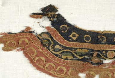 Coptic. <em>Neck Band Fragment with Botanical and Geometric Decoration</em>, 4th-7th century C.E. Flax, wool, 4 1/2 x 10 1/2 in. (11.4 x 26.7 cm). Brooklyn Museum, Brooklyn Museum Collection, X941. Creative Commons-BY (Photo: Brooklyn Museum (in collaboration with Index of Christian Art, Princeton University), CUR.X941_detail01_ICA.jpg)
