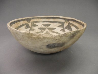 Ancient Pueblo (Anasazi). <em>Bowl</em>, ca. 900-1300 C.E. Clay, slip, 3 3/4 x 8 1/2 in.  (9.5 x 21.6 cm). Brooklyn Museum, Brooklyn Museum Collection, X949.6. Creative Commons-BY (Photo: Brooklyn Museum, CUR.X949.6_view1.jpg)