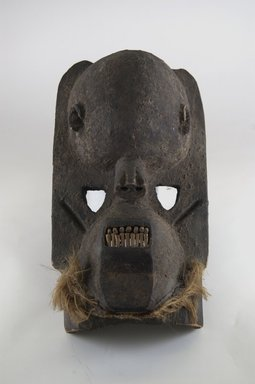 Dogon. <em>Mask</em>, late 19th or early 20th century. Wood, fiber, pigment, 13 x 6 1/4 x 8 in. (33.1 x 15.8 x 20.3 cm). Brooklyn Museum, Brooklyn Museum Collection, X956.6. Creative Commons-BY (Photo: Brooklyn Museum, CUR.X956.6_front_PS5.jpg)
