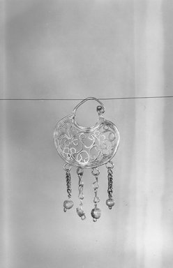 <em>Single Earring</em>, 2nd-3rd century C.E. Gold, glass, 1 3/4 x 15/16 in. (4.4 x 2.4 cm). Brooklyn Museum, Brooklyn Museum Collection, X16. Creative Commons-BY (Photo: Brooklyn Museum, CUR.x16_NegA_print_bw.jpg)