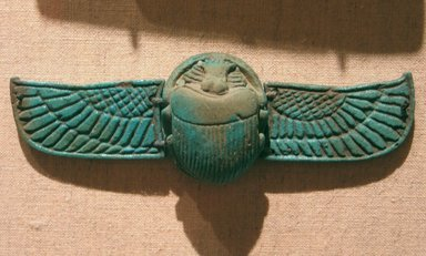 <em>Winged Scarab</em>, 664-332 B.C.E. Faience, 1/2 x 1 1/16 x 1 5/16 in. (1.2 x 2.7 x 3.3 cm). Brooklyn Museum, Gift of the Egypt Exploration Fund, 15.523. Creative Commons-BY (Photo: Brooklyn Museum, CUR.x249.42_wwgA-3.jpg)