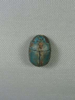 <em>Scarab</em>, ca.1630-1539 B.C.E. Steatite, glaze, 1/2 x 3/4 x 1 1/16 in. (1.2 x 1.9 x 2.7 cm). Brooklyn Museum, Charles Edwin Wilbour Fund, 44.123.89. Creative Commons-BY (Photo: Brooklyn Museum, CUR_44.123.89_view01.jpg)