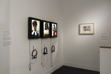 Nina Katchadourian (American, born 1968). <em>In a Room Full of Strangers</em>, 2013. 3-channel video:  3 bespoke wood frames, 3 custom monitors, 3 Brightsign media players, 3 SD cards, back up video files on a USB thumb drive, 3 headphones, 20 x 56 in. (50.8 x 142.2 cm). Brooklyn Museum, William K. Jacobs, Jr. Fund, 2014.83. © artist or artist's estate (Photo: Brooklyn Museum, DIG_E_2015_Diverse_Works_04_2014.83_PS8.jpg)