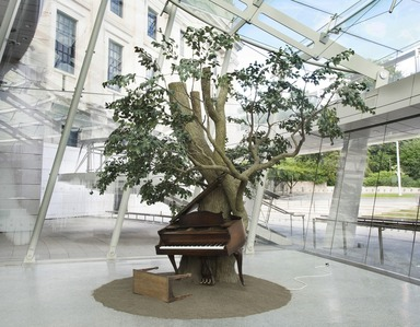 Sanford Biggers (American, born 1970). <em>Blossom</em>, 2007. Steel, plastic and synthetic fibers, wood, MIDI player piano system, Zoopoxy, pigment, soil, modelling clay, polyurethane foam, 12 x 18 x 15 feet (365.9 x 548.8 x 457.3 cm). Brooklyn Museum, Purchase gift of Toby Devan Lewis, Charles and Amber Patton, and an anonymous donor, gift of the Contemporary Art Council, and the Mary Smith Dorward Fund, 2011.10. © artist or artist's estate (Photo: Brooklyn Museum, DIG_E_2017_The_Legacy_of_Lynching_2011.10_view01_PS11.jpg)
