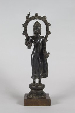 <em>Standing Buddha</em>, 7th-8th century. Bronze, 10 3/4 x 3 3/8 x 2 in.  (27.3 x 8.6 x 5.1 cm). Brooklyn Museum, Gift of Georgia and Michael de Havenon, 2013.101.3. Creative Commons-BY (Photo: Brooklyn Museum, L2001.4_PS5.jpg)