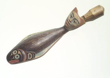 Charles Edenshaw (Haida, 1834-1924). <em>Clapper in Form of a Fish with Human Head for Finger Lever</em>, pre-1864. Cedar wood, pigment, 9 3/4 x 2 3/4 in. (24.8 x 7.0 cm). Collection of Christopher B. Martin, L61.3.1. Creative Commons-BY (Photo: Brooklyn Museum, L61.3.1_transp5628.jpg)