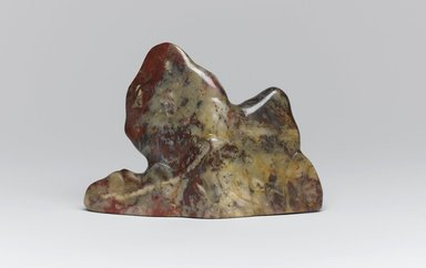 <em>Brush Rest</em>, 1644-1911. Jixue (chicken blood) stone, 4 1/2 x 1 x 3 1/8 in. (11.4 x 2.5 x 7.9 cm). Lent by the Guennol Collection, L81.11.4. Creative Commons-BY (Photo: Brooklyn Museum, L81.11.4_view1_PS1.jpg)