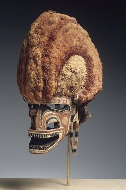 <em>Mask (Tatanua)</em>, 19th century. Wood, rattan, bark cloth, fiber, tapestry turban snail (Turbo petholatus) opercula, pigment, 15 1/4 x 9 x 12 in. (38.7 x 22.9 x 30.5 cm). Brooklyn Museum, Brooklyn Museum Collection, X1033. Creative Commons-BY (Photo: Brooklyn Museum, X1033_transpc003.jpg)