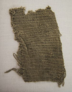 Huaca Prieta. <em>Textile Fragment, undetermined</em>, 3000-1800 B.C.E. Cotton, 4 1/8 x 2 3/8in. (10.5 x 6cm). Brooklyn Museum, Brooklyn Museum Collection, X1048.2. Creative Commons-BY (Photo: Brooklyn Museum, X1048.2_front_PS5.jpg)
