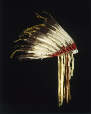 Osage. <em>Headdress</em>, late 19th-early 20th century. Wool, felt, cloth, golden eagle feathers, horse hair, glass beads, hide, weasel fur, silk, sinew, 16 1/2 x 22 x 22 in. (41.9 x 55.9 x 55.9 cm). Brooklyn Museum, Brooklyn Museum Collection, X1053. Creative Commons-BY (Photo: Justin Kerr, X1053_SL1.jpg)