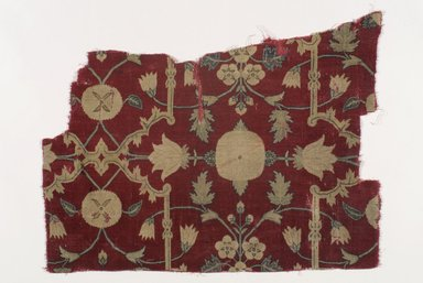 <em>Fragment of a Carpet with Pattern of Lattice and Blossoms</em>, mid 17th century. Pashmina wool, silk, 18 1/2 x 25 in. (47 x 63.5 cm). Brooklyn Museum, Brooklyn Museum Collection, X1103.1. Creative Commons-BY (Photo: Brooklyn Museum, X1103.1.jpg)