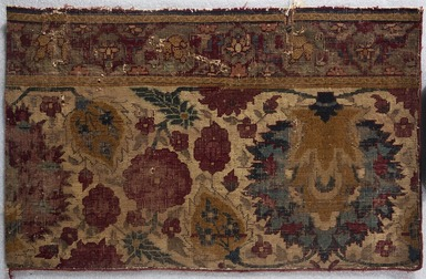 <em>Border Fragment of a Carpet with Pattern of Scrolling Vines and Animals</em>, early 17th century. Wool and cotton, 31 x 18 1/2 in. (78.7 x 47 cm). Brooklyn Museum, Brooklyn Museum Collection, X1103.3. Creative Commons-BY (Photo: Brooklyn Museum, X1103.3_PS11.jpg)