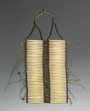 Native American. <em>Breastplate</em>, late 19th century. Bone, hide, beads, metal, 24 1/2 x 10 x 1/8 in. (62.2 x 25.4 x 0.3 cm). Brooklyn Museum, Brooklyn Museum Collection, X1104.4. Creative Commons-BY (Photo: Brooklyn Museum, X1104.4_PS2.jpg)