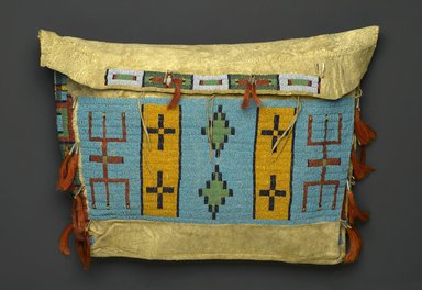 Sioux. <em>Tipi Bag or Possible Bag</em>, ca. 1860-1900. Hide, beads, tin cones, horse hair, 15 1/2 x 20 1/2 in. (39.4 x 52.1 cm). Brooklyn Museum, Brooklyn Museum Collection, X1111.1. Creative Commons-BY (Photo: Brooklyn Museum, X1111.1_PS1.jpg)