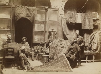 <em>[Untitled] (Rug Merchant at Bazaar in Cairo)</em>. Albumen silver photograph, photo: 7 3/4 x 10 1/2 in. (19.7 x 26.6 cm). Brooklyn Museum, Brooklyn Museum Collection, X1131.1 (Photo: Brooklyn Museum, X1131.1_PS1.jpg)