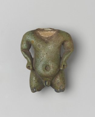 <em>Fragmentary Amulet of Pataikos</em>, 1539-30 B.C.E. Faience, 1 15/16 x 1 1/2 in. (5 x 3.8 cm). Brooklyn Museum, Brooklyn Museum Collection, X1182.2. Creative Commons-BY (Photo: Brooklyn Museum, X1182.2_front_PS2.jpg)