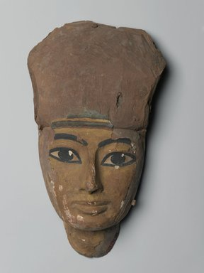 <em>Face from a Coffin</em>, 1075-656 B.C.E. Wood, gesso, pigment, 6 1/16 x 3 1/8 x 10 7/16 in. (15.4 x 7.9 x 26.5 cm). Brooklyn Museum, Brooklyn Museum Collection, X1182.3. Creative Commons-BY (Photo: Brooklyn Museum, X1182.3_front_PS2.jpg)