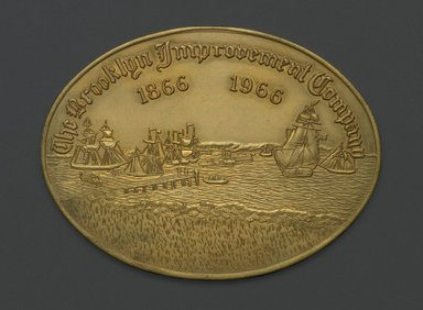 American. <em>Coin, The Brooklyn Improvement Company 1866 - 1966</em>, ca. 1966. Gilded metal, 3 1/16 x 4 1/16 x 1/8 in. (7.8 x 10.3 x 0.3 cm). Brooklyn Museum, Brooklyn Museum Collection, X1195. Creative Commons-BY (Photo: Brooklyn Museum, X1195_PS2.jpg)