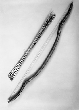 <em>Large Bow and 8 Arrows, Quiver</em>. Wood, metal, bone, sinew, hide, feather, string, Arrow bundle: 36 3/4 x 1 1/4 x 1 3/4in. (93.3 x 3.2 x 4.4cm). Brooklyn Museum, Brooklyn Museum Collection, X351. Creative Commons-BY (Photo: Brooklyn Museum, X351_bw.jpg)