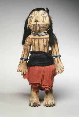 Mohave. <em>Brown Pottery Doll with Painted Line Designs</em>, late 19th-early 20th century. Clay, slip, yarn, cloth, string, beads, hair, resin, 8 1/2 x 4 x 2 in. (21.6 x 10.2 x 5.1 cm). Brooklyn Museum, Brooklyn Museum Collection, X586. Creative Commons-BY (Photo: Brooklyn Museum, X586_transpc003.jpg)