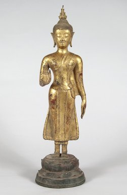 <em>Standing Buddha</em>. Gilded bronze, polychrome, 18 7/8 x 5 1/2 x 5 in. (47.9 x 14 x 12.7 cm). Brooklyn Museum, Brooklyn Museum Collection, X630 (Photo: , X630_PS5.jpg)