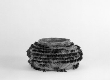 Pomo. <em>Single/Coiled, Ribbed Weave Basket decorated with blue and green feathers</em>, late 19th-early 20th century. Fiber, feathers, 3 1/8 x (dia) 3 1/2 in. or (8.0 x 8.9 cm). Brooklyn Museum, Brooklyn Museum Collection, X719.3. Creative Commons-BY (Photo: Brooklyn Museum, X719.3_bw.jpg)