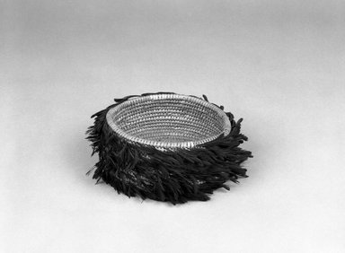 Possibly Pomo. <em>Coiled Basket</em>, late 19th-early 20th century. Feathers, fiber, 2 1/8 x (dia) 4 1/2 in. (5.4 x 11.4 cm). Brooklyn Museum, Brooklyn Museum Collection, X719.4. Creative Commons-BY (Photo: Brooklyn Museum, X719.4_bw.jpg)