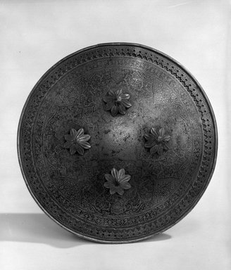 <em>Circular Shield</em>. Steel inlaid with gold, 12 in. (diam.) (30.5 cm). Brooklyn Museum, Brooklyn Museum Collection, X743.1. Creative Commons-BY (Photo: Brooklyn Museum, X743.1_bw_SL4.jpg)
