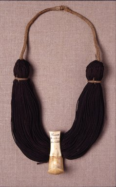 Hawaiian. <em>Necklace (Lei Niho Palaoa)</em>, early 19th century. Human hair, sperm whale tooth, fiber, pigment, 14 x 7 x 2 1/2 in. (35.6 x 17.8 x 6.4 cm). Brooklyn Museum, Brooklyn Museum Collection, X839.3. Creative Commons-BY (Photo: Brooklyn Museum, X839.3.jpg)