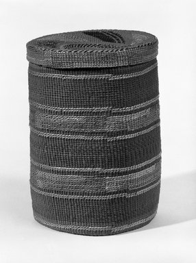 Tlingit. <em>Twined Cylinder Basket with Lid with False Embroidery</em>, early 20th century. Spruce root, grass, dye, 7 1/2 x 5 1/2in. (19 x 14cm). Brooklyn Museum, Brooklyn Museum Collection, X854.20a-b. Creative Commons-BY (Photo: Brooklyn Museum, X854.20a-b_bw.jpg)