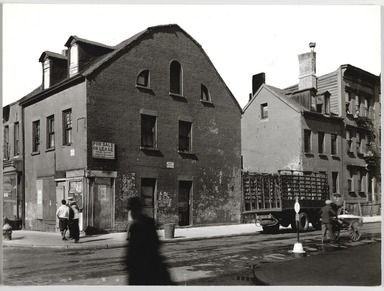 Berenice Abbott (American, 1898-1991). <em>Mulbery and Prince Streets, Manhattan</em>, October 25, 1935. Gelatin silver photograph, 7 x 9 3/8 in. (17.8 x 23.8 cm). Brooklyn Museum, Brooklyn Museum Collection, X858.3 (Photo: , X858.3_PS9.jpg)