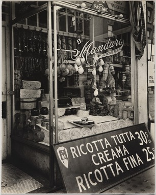 Berenice Abbott (American, 1898-1991). <em>Cheese Store: 276 bleeker Street, Manhattan</em>, February 2, 1937. Gelatin silver photograph, 9 9/16 x 7 9/16 in. (24.3 x 19.2 cm). Brooklyn Museum, Brooklyn Museum Collection, X858.41 (Photo: , X858.41_PS9.jpg)