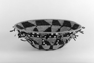 Pomo. <em>Gift or Jewel Basket with black and red feathers</em>, late 19th-early 20th century. Fiber, feather, shell bead, 2 3/4 x 9 1/4 in. (7 x 23.5 cm). Brooklyn Museum, Brooklyn Museum Collection, X719.1. Creative Commons-BY (Photo: Brooklyn Museum, x719.1_bw.jpg)