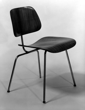Charles Eames (American, 1907-1978). <em>DCM (Dining Chair Metal)</em>, Designed 1946. Birch plywood, metal, 29 1/4 x 19 1/2 x 22 3/4 in. (74.3 x 49.5 x 57.8 cm). Brooklyn Museum, Brooklyn Museum Collection, X748. Creative Commons-BY (Photo: Brooklyn Museum, x748_bw.jpg)