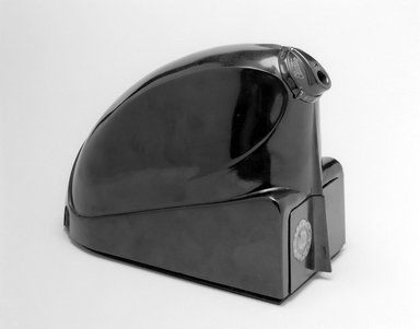 "Stile Craft Manufacturers, Inc.. <em>Pencil Sharpener, ""Electro-Pointer,""</em> ca. 1930. Molded plastic, metal, 5 7/8 x 3 5/8 x 8 1/4 in. (14.9 x 9.2 x 21 cm). Brooklyn Museum, Brooklyn Museum Collection, X908a-c. Creative Commons-BY (Photo: Brooklyn Museum, x908a-c_view1_bw.jpg)"