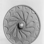 Spindle Whorl (Sulsultin) Carved with Wheel Design