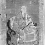 Buddhist Monk Seated and Holding Staff