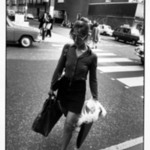 Untitled (Woman with Purse and Portfolio Crossing the Street), from Women are Beautiful Series