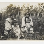 [Untitled] (Two Women with Children Sitting in a Field)