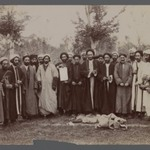 A Group of Religious Men in Religious Garb  holding up a Piece of Calligraphy, One of 274 Vintage Photographs