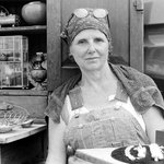 [Untitled] (Seated Woman in Overalls Selling Antiques)
