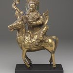 Achi Chokyi Drolma on a Horse