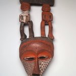Triangular Mask Surmounted by Male and Female Figures