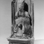 Figure Seated On a Throne