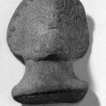 Head with Scroll Design on Face