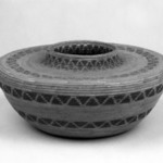 Coiled Basket with Flat Shoulders and Short Straight Neck decorated with bands of triangles